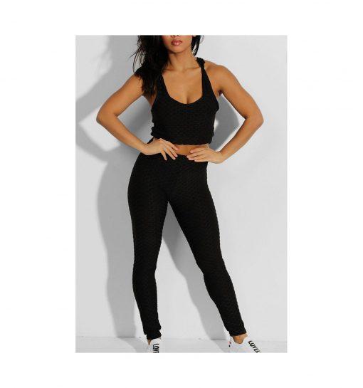 Ensemble de sport pour femme avc legging et brassiere top push up noir pose
