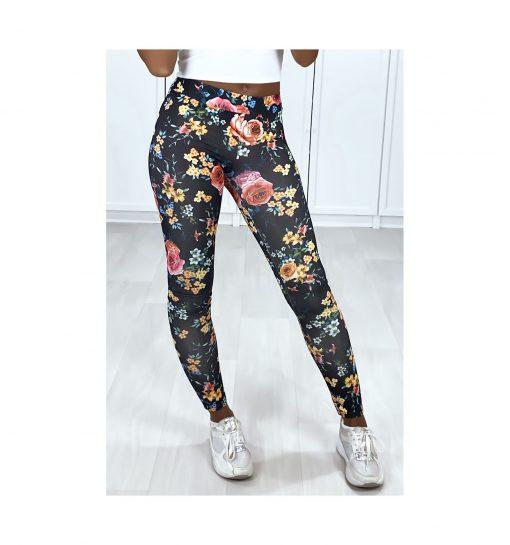 legging noir motif fleurs couleurs pose jambe tendue