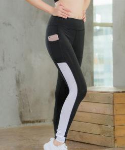 legging sport avec poche telephone noir ligne blanche