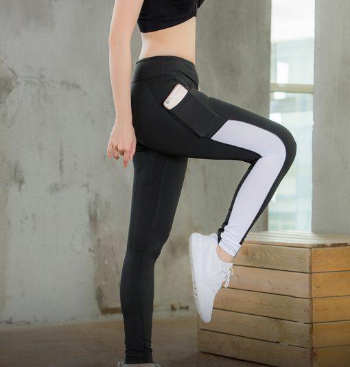 legging sport avec poche telephone noir ligne blanche genou haut