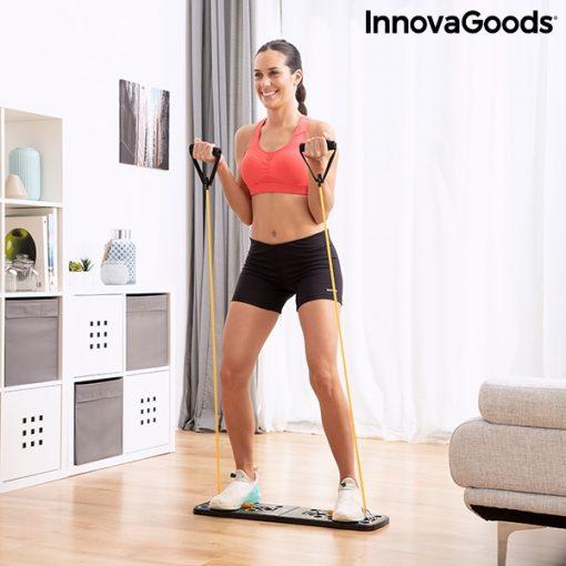 Femme utilisant planche a pompes avec elastiques a la maison
