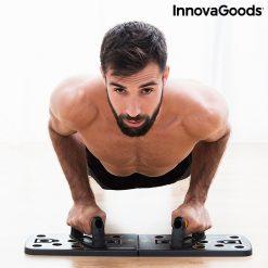 Homme sportif utilisant planche-a pompes avec elastiques