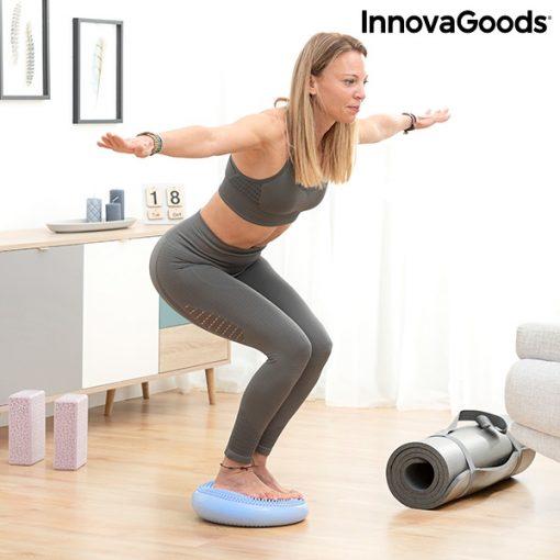 femme sur coussin equilibre